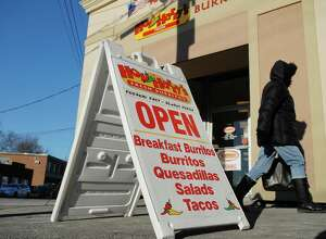 A sign on the street announces the opening  at the reopened location for the Hot Harry?s Burrito chain, on Tuesday, Jan. 12, 2010, following the reconstruction of the restaurant which was damaged last October by fire.  The business is located at 1625 Union St. in Schenectady, NY.  (Paul Buckowski / Times Union)