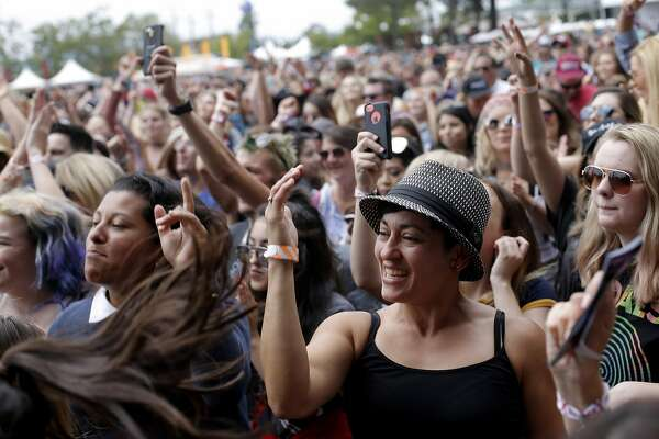 Partygoers dance during BottleRock at the Napa Valley Expo on Friday, May 26, 2017, in Napa, Calif.