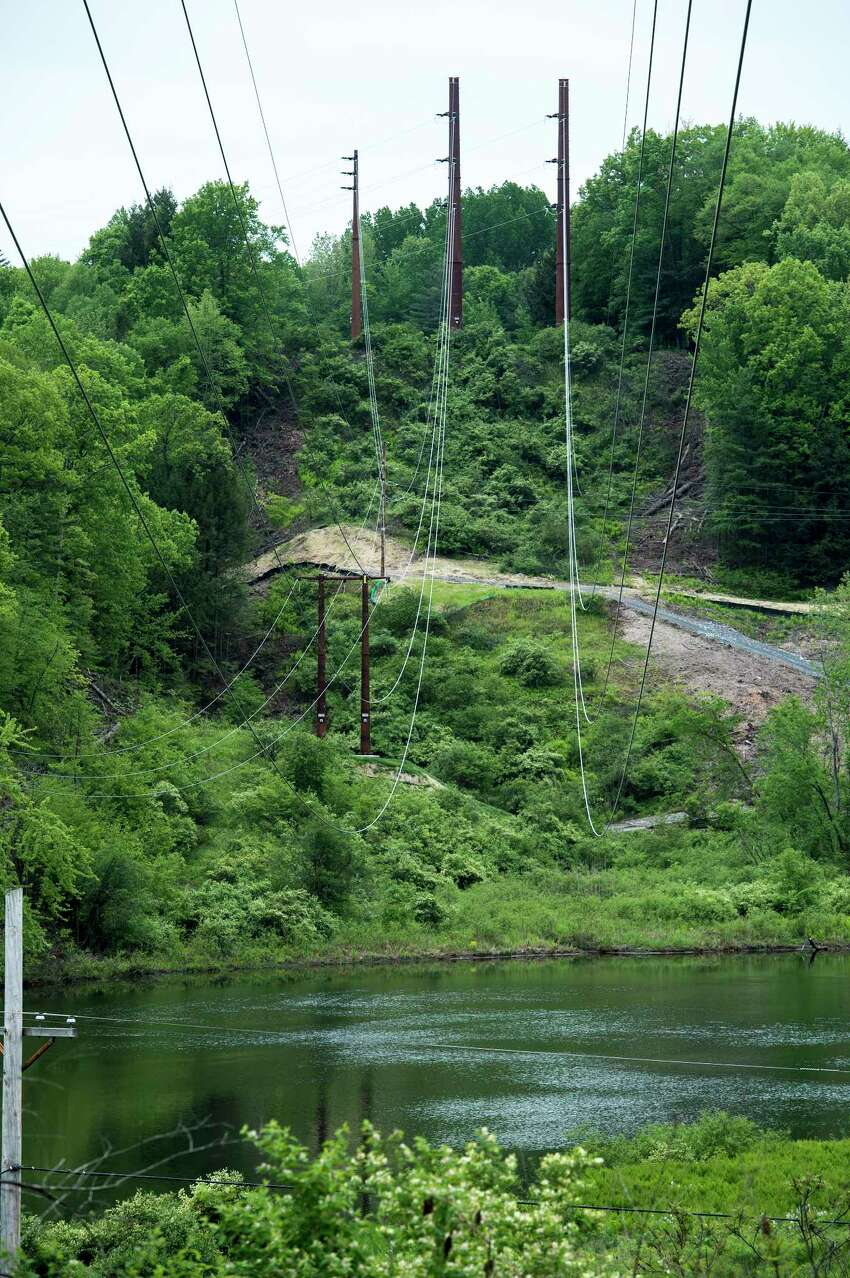 New cable hangs over an 1899 foot span across the Battenkill River Tuesday May 23, as part of the upgrade to the power lines put in by National Grid in Greenwich, N.Y. (Skip Dickstein/Times Union)