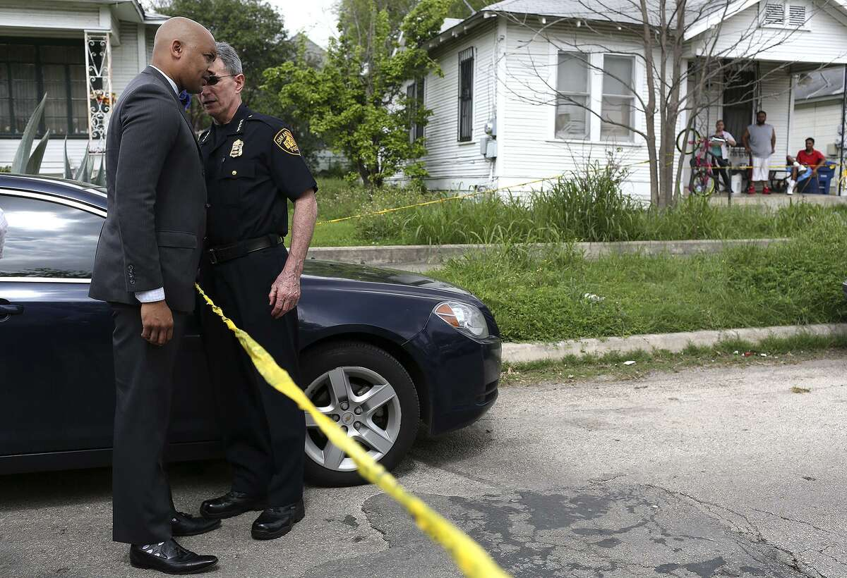 District 2 City Councilman Alan Warrick, left, talks with San Antonio Police Department Chief William McManus at the scene of a shooting, described as domestic violence between two brothers over a woman, on Nevada Street in San Antonio on Friday, March 18, 2016. With the recent increase of gang violence on the Eastside, Warrick and McManus came to the scene for more information.
