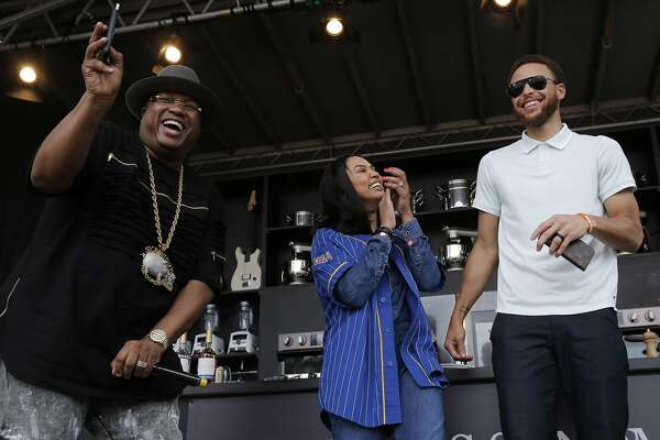 From left: E-40, Ayesha Curry and Stephen Curry during BottleRock at the Napa Valley Expo on Friday, May 26, 2017, in Napa, Calif.