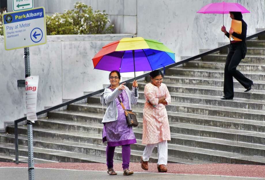 Colorful umbrellas are the order of the day on the Empire State Plaza on a rainy Friday May 26, 2017 in Albany, NY.  (John Carl D'Annibale / Times Union) Photo: John Carl D'Annibale / 40040615A