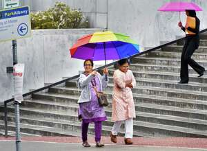 Colorful umbrellas are the order of the day on the Empire State Plaza on a rainy Friday May 26, 2017 in Albany, NY.  (John Carl D'Annibale / Times Union)