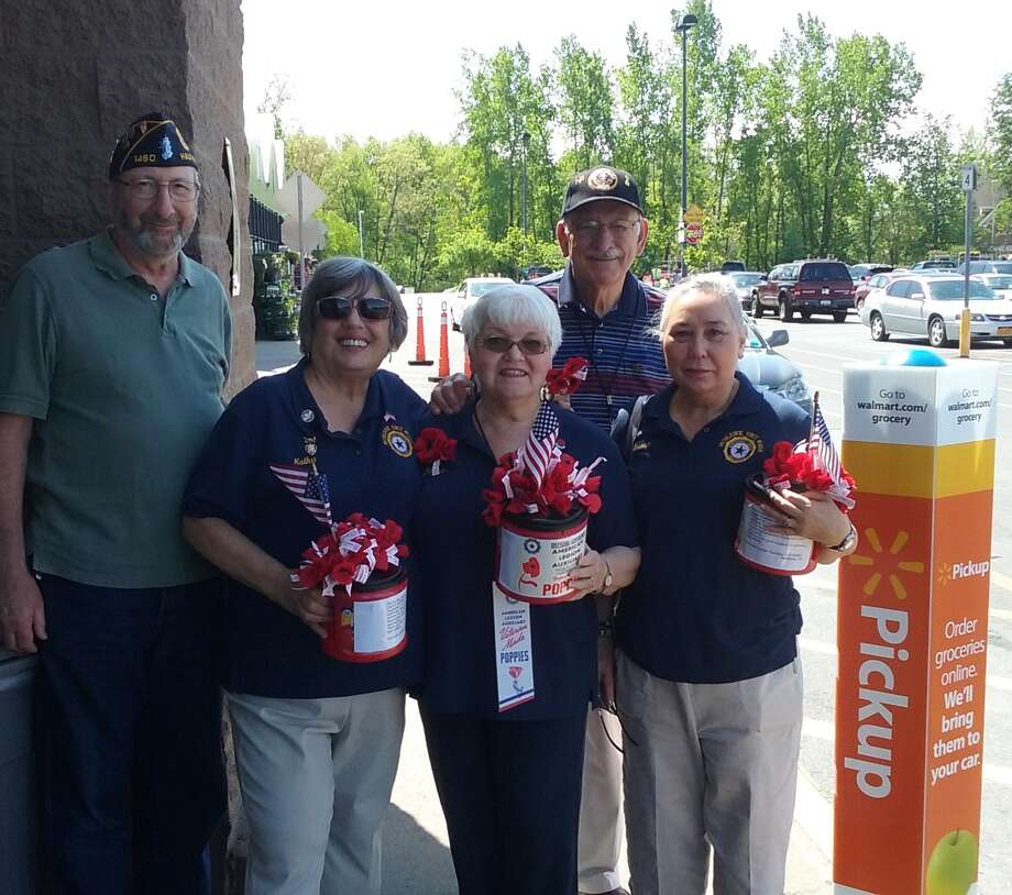 Auxiliary Unit 1450 Mohawk Legion Post works with Legion members to promote National Poppy Day recently in Halfmoon, and as they honor veterans, their families and communities. The response is overwhelming, the auxiliary unit says, and it is thankful to live in a caring community and to have its Legion family to share it all with. Shown here: Sam Gallucci, Kathy Gallucci, Elaine Olsakovsky, Jim Olsakovsky and Poppy Chairman Susan Carmack. (Kathy Gallucci)