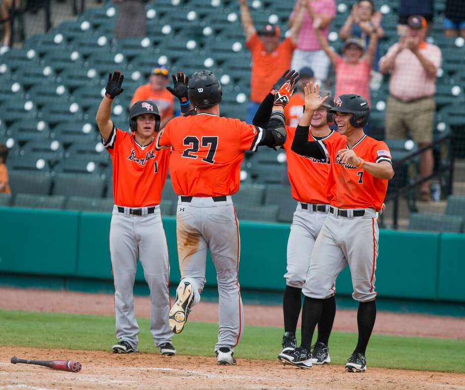 Sam Houston St. teammates celebrate as Sam Houston St. pitcher Blake Chisolm (27) inside the park homerun in the eighth inning of a baseball game during the Southland Conference Tournament between University of New Orleans vs Sam Houston State University at Constellation Field, Friday, May 26, 2017, in Sugarland. Sam Houston St. defeated New Orleans 7-1. (Juan DeLeon/for the Houston Chronicle ) Photo: Juan DeLeon/For The Chronicle