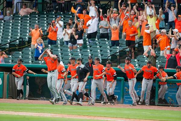 Sam Houston St. players celebrate after defeating New Orleans after a baseball game during the Southland Conference Tournament between University of New Orleans vs Sam Houston State University at Constellation Field, Friday, May 26, 2017, in Sugarland. Sam Houston St. defeated New Orleans 7-1. (Juan DeLeon/for the Houston Chronicle )