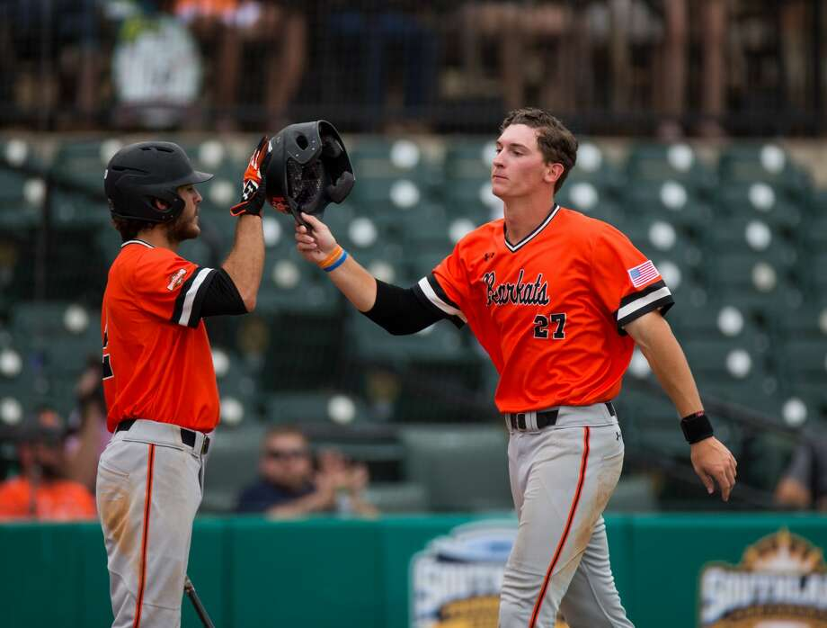 Sam Houston St. pitcher Blake Chisolm (27) celebrates with teammate Sam Houston St. infielder Riley McKnight (2) after scoring  in the sixth inning of a baseball game during the Southland Conference Tournament between University of New Orleans vs Sam Houston State University at Constellation Field, Friday, May 26, 2017, in Sugarland. Sam Houston St. defeated New Orleans 7-1. (Juan DeLeon/for the Houston Chronicle ) Photo: Juan DeLeon/For The Chronicle