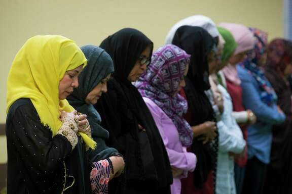 Monica Morales, left, joins other Latina Muslims for prayer at a service at Houston's Centro Islamico, which is believed to be the nation's only Spanish-speaking mosque.