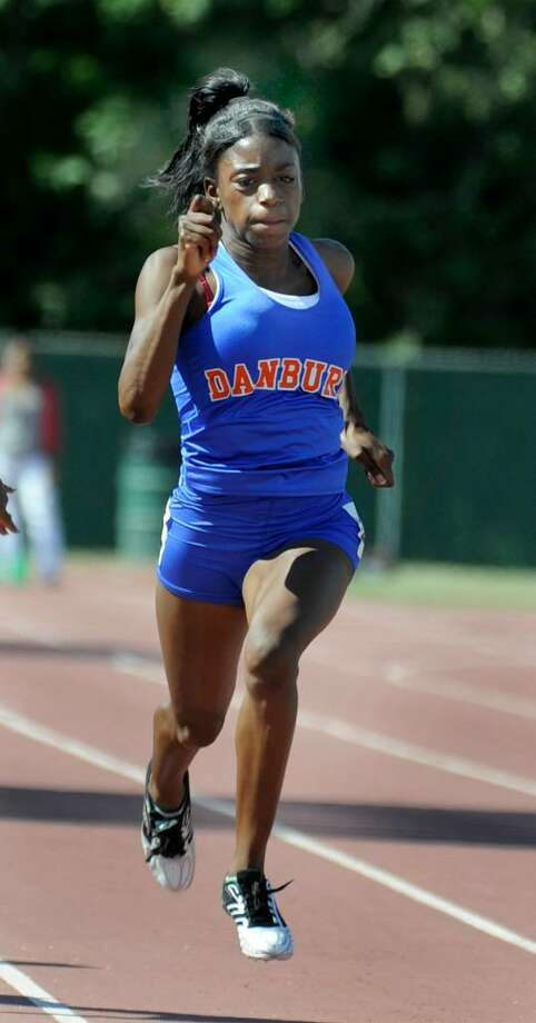 Teyanna Green, right, of Danbury High School, won the 100 meter dash at the State Track Open in New Britain Monday, June 7, 2010. She reached a new state open record of 11.66. Photo: Carol Kaliff / The News-Times