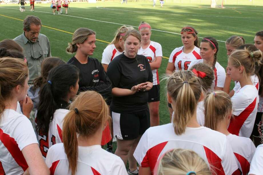 Greenwich Cardinals coach Caitlin Keane talks to her players after Monday afternoon's 20-8 win over Guilford. Photo: David Ames, David Ames/For Greenwich Time / Greenwich Time