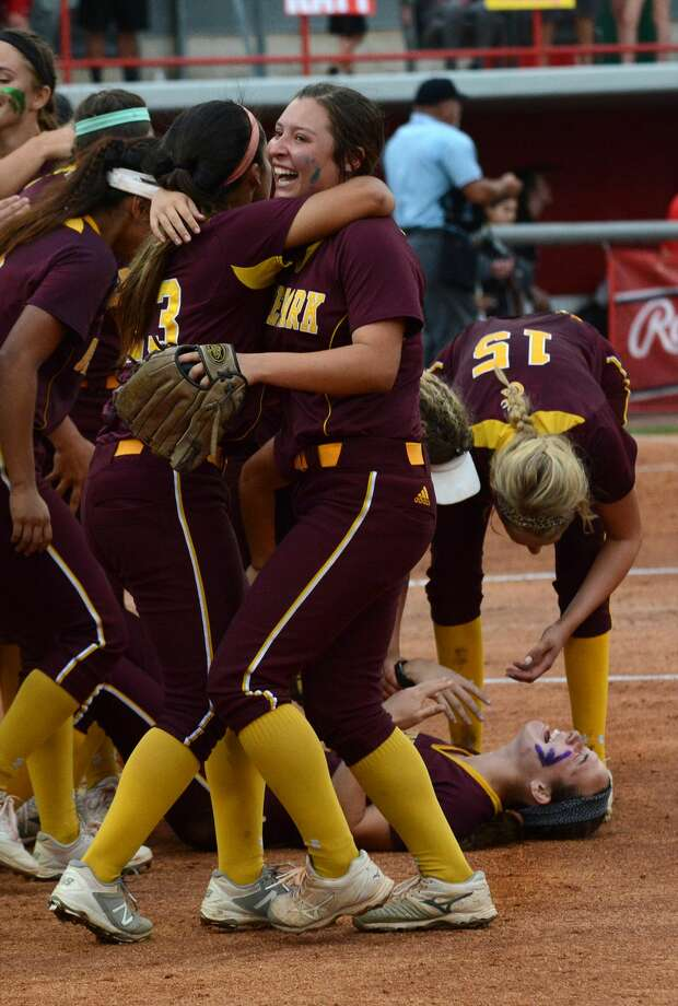 Deer Park sophomore second baseman Sarah Vanderford, center, shares a a hug with freshman Alaina Cortez, left, as senior Maddie Nelson (15) tries to congratulate senior Erin Edmoundson, bottom right, after the final out of the Deer's 6-5 win over the Katy Tigers in game two of their Class 6A Region III final series at Cougar Softball Stadium on the campus of the University of Houston on Friday, May 26, 2017. (Photo by Jerry Baker/Freelance) Photo: Jerry Baker/For The Chronicle