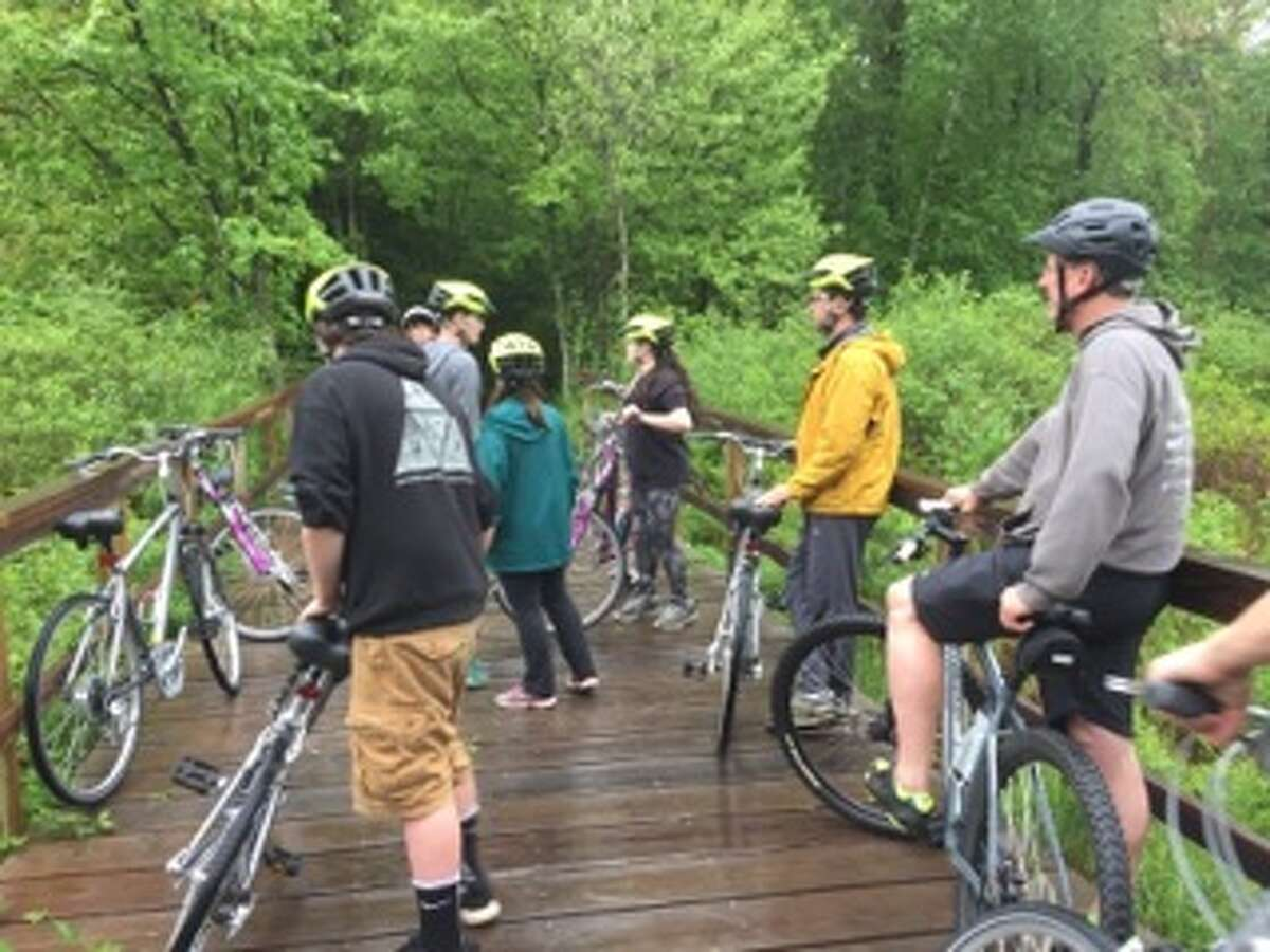 Chris Collins and buddies Mike Romanoski and Kannan Kristel led a half-dozen teens working to overcome addiction along the Gurney Lane Recreation Area bike path, as one of the ways their six-month-old nonprofit Freedom Machines is paying it forward.