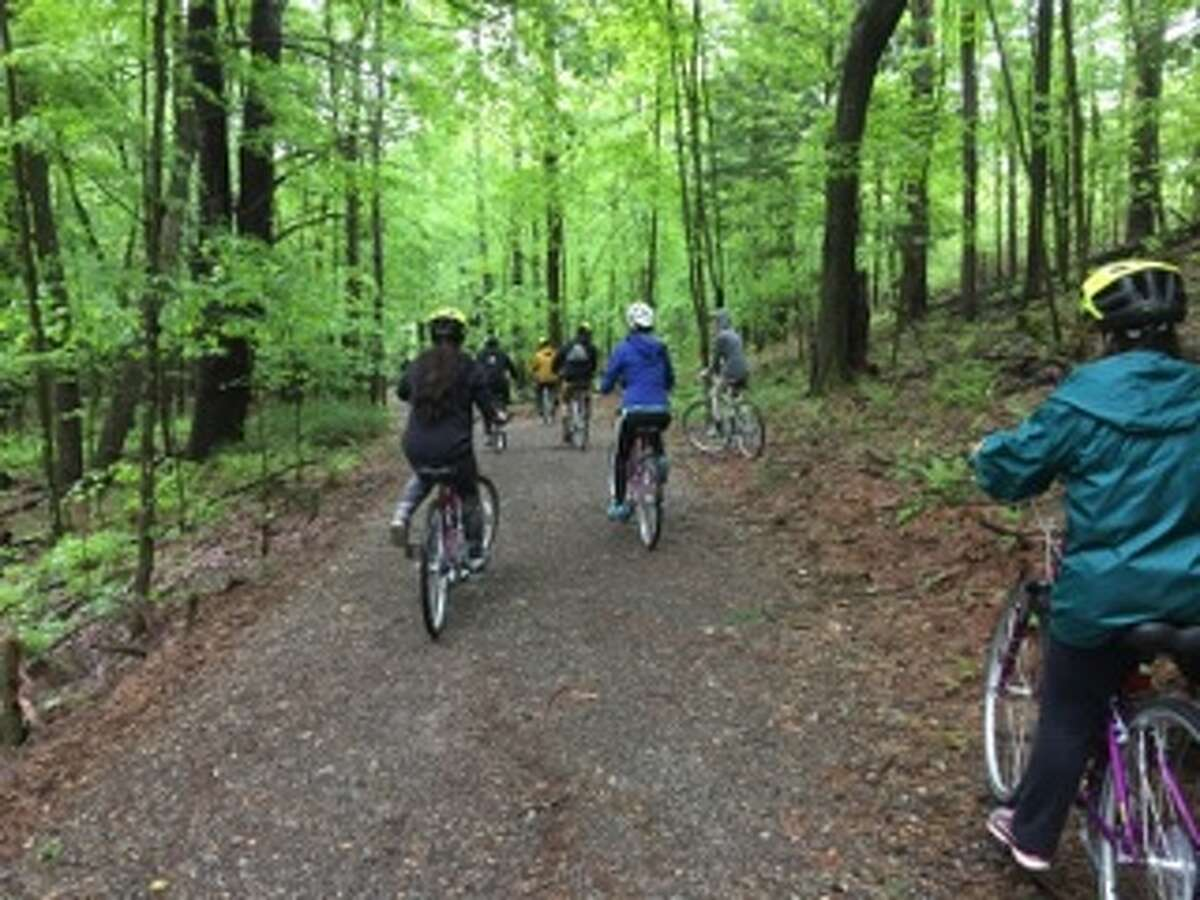 Chris Collins and buddies Mike Romanoski and Kannan Kristel led a half-dozen teens working to overcome addiction along the Gurney Lane Recreation Area bike path, as one of the ways their six-month-old nonprofit Freedom Machines is paying it forward. (Provided photo)