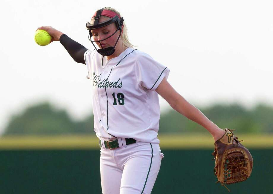 The Woodlands starting pitcher Emily Langkamp (18) reacts after a 2-run error scores Deja Hubbard and Catarina Esteves of Bowie during the third inning in Game 2 of a Region II-6A final high school softball series at the Mumford Athletic Complex, Friday, May 26, 2017, in Mumford. Photo: Jason Fochtman, Staff Photographer / © 2017 Houston Chronicle