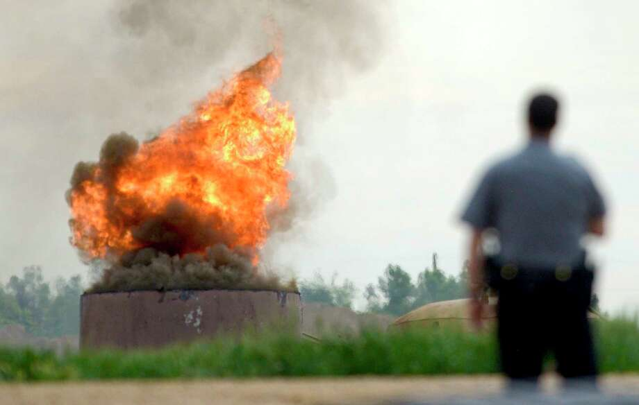 An oil tank burns on Thursday after a tank battery owned by Anadarko Petroleum Corp. exploded in Weld County, Colo. One worker died in the blast, and three others suffered burns. Photo: Lewis Geyer, MBO / Daily Camera
