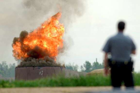 An oil tank burns on Thursday after a tank battery owned by Anadarko Petroleum Corp. exploded in Weld County, Colo. One worker died in the blast, and three others suffered burns.