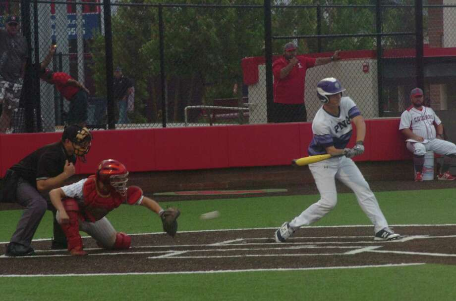 PN-G's Brandon Morse checks his swing in the first inning of the Indians' Class 5A regional semifinal game against Tomball on Friday at Crosby High School. Photo: Danny Shapiro/The Enterprise