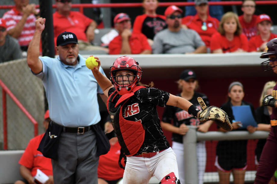 Katy sophomore catcher Cait Calland tries to turn a double play after getting a force-out at home against Deer Park in game two of their Class 6A Region III final series at Cougar Softball Stadium on the campus of the University of Houston on Friday, May 26, 2017. (Photo by Jerry Baker/Freelance) Photo: Jerry Baker/For The Chronicle