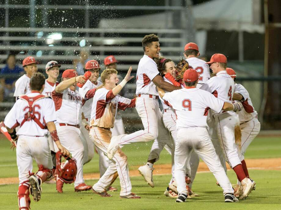 The Travis Tigers celebrate their 15-3 playoff win over the North Shore Mustangs in the High School Baseball Playoffs on Friday, May 26, 2017 at Reckling Park at Rice University in Houston Texas. Photo: Wilf Thorne/For The Chronicle