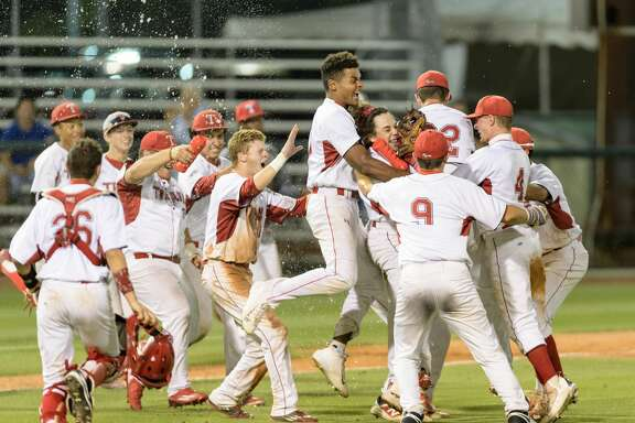 The Travis Tigers celebrate their 15-3 playoff win over the North Shore Mustangs in the High School Baseball Playoffs on Friday, May 26, 2017 at Reckling Park at Rice University in Houston Texas.