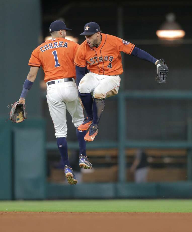 Houston Astros  Carlos Correa (1) and George Springer (4) celebrate the Astros 2-0 win over Baltimore Orioles at Minute Maid Park on Friday, May 26, 2017, in Houston. ( Elizabeth Conley / Houston Chronicle ) Photo: Elizabeth Conley/Houston Chronicle
