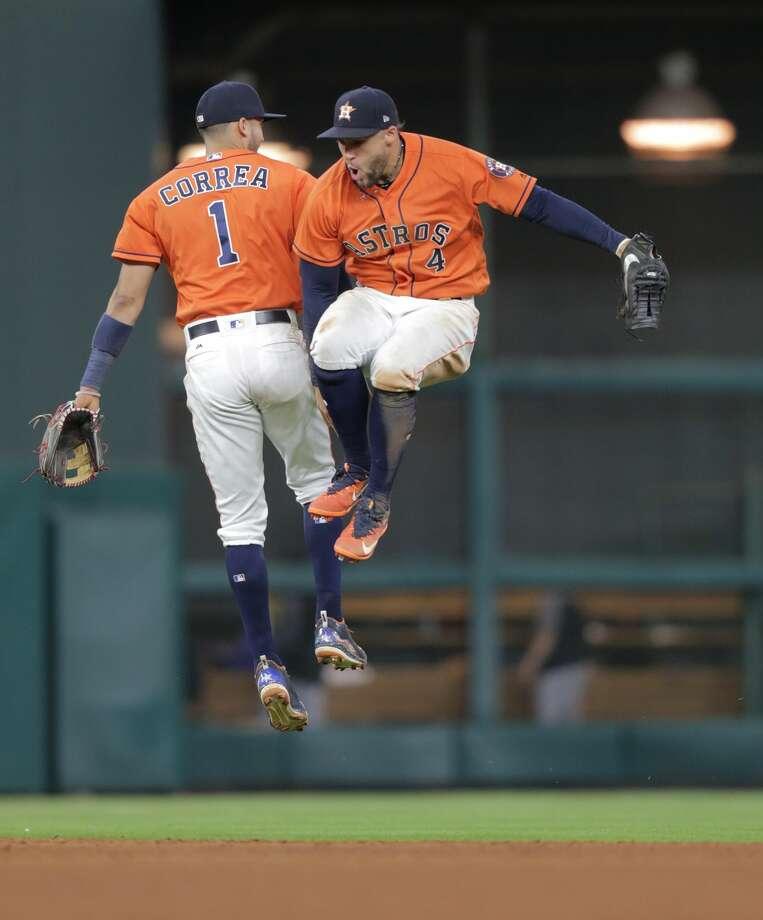 9f5b5abde Houston Astros Carlos Correa (1) and George Springer (4) celebrate the  Astros