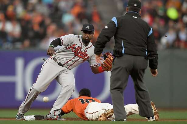 SAN FRANCISCO, CA - MAY 26:  Eduardo Nunez #10 of the San Francisco Giants steals second base beating the throw down to Brandon Phillips #4 of the Atlanta Braves in the bottom of the first inning at AT&T Park on May 26, 2017 in San Francisco, California.  (Photo by Thearon W. Henderson/Getty Images)