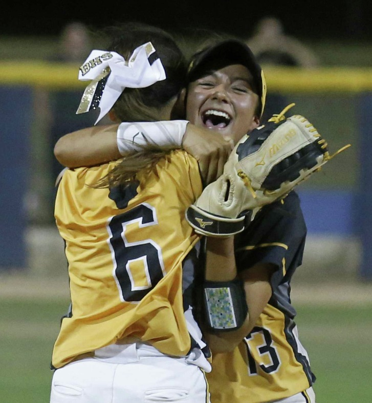Brennan's Christine Zayas-Baez (left) and teammate Alexandria Yorkman celebrate after winning Game 2 of their Region IV-6A regional final series against New Braunfels Canyon at St. Marys University on May 26, 2017.