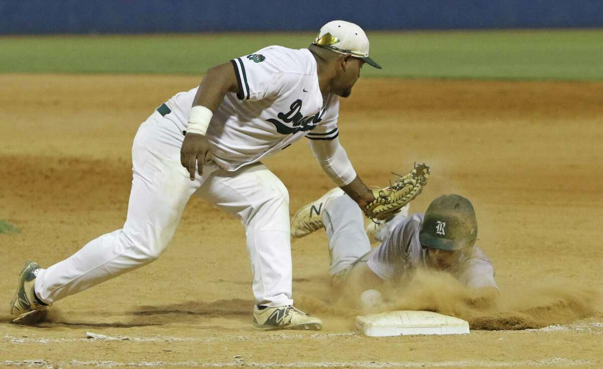 Southwest?•s Eric Hernandez is late on the pick-off attempt on Reagan?•s Hilton Brown from Game 2 of Region IV-6A semifinal series between Reagan and Southwest on Friday, May 26, 2017.