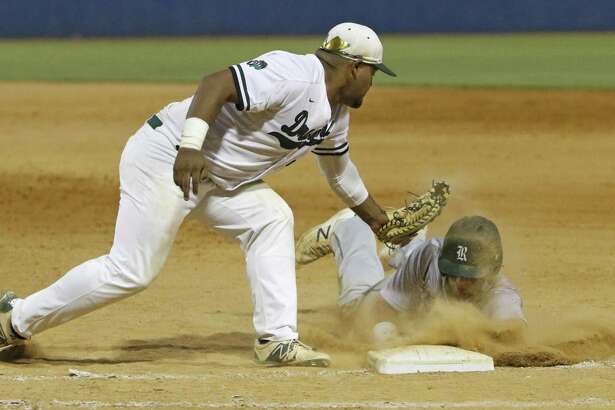 SouthwestÕs Eric Hernandez is late on the pick-off attempt on ReaganÕs Hilton Brown from Game 2 of Region IV-6A semifinal series between Reagan and Southwest on Friday, May 26, 2017.