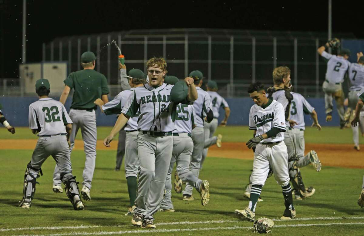 Reagan's Jake Hoggatt celebrates with his teammates after the Rattlers beat Southwest in Game 2 of a Region IV-6A semifinal series Friday. Hoggatt retired 10 consecutive batters through six innings.