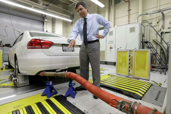 FILE - In this Sept. 30, 2015, file photo, a 2013 Volkswagen Passat with a diesel engine is evaluated at the emissions test lab in El Monte, Calif. Real world pollution from diesel trucks, buses and cars globally is more than 50 percent higher than what government lab testing says it should be. And that translates to an extra 38,000 deaths worldwide from soot and smog, a new study say.  (AP Photo/Nick Ut, File)