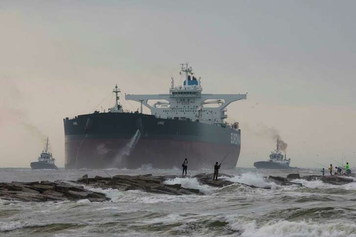 The largest tanker to dock in a Gulf of Mexico port travels threw the Port of Corpus Christi shipping channel in Port Aransas, Texas, on Friday, May 26, 2017. (Courtney Sacco/Corpus Christi Caller-Times via AP)