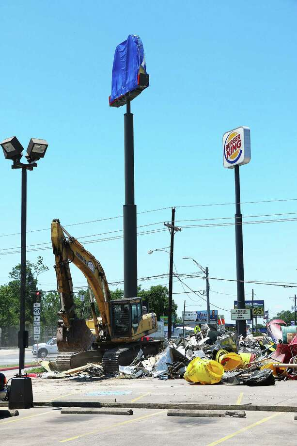 McDonald's customers were shocked May 24 to see the restaurant demolished. The iconic Golden Arches left behind were a good sign signaling the imminent return of the restaurant. Photo: David Taylor
