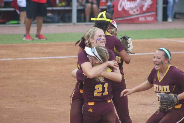 Deer Park pitcher Maddie Nelson and first baseman Alyssa Hernandez embrace, while the rest of the infield start the celebration to clinching the Region III title Friday night.