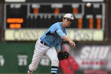 Wilton's Billy Black delivers a pitch during the FCIAC championship game against Ridgefield.