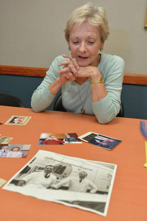 Corey Weber looks over some old family photos of her father Curt and his business in Norwalk on Wednesday, May 24. Curt Mertin, longtime operator of Norwalk Beef & Pork in Ludlow Plaza, died May 12 in Litchfield at age 97. Born in Liegnitz, Silesia, Mertin came to the United States with his wife after World War II and realized his dream of opening a homemade sausage shop, which he ran for many years in Ludlow Plaza in Roger Square in East Norwalk. Photo: Alex Von Kleydorff / Hearst Connecticut Media / Norwalk Hour
