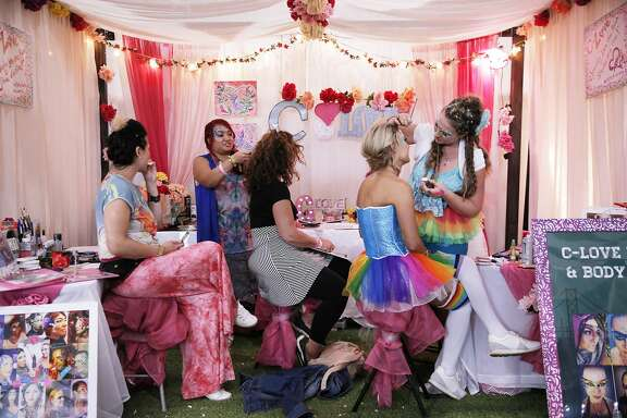 From right: Cassandra Love Lambert touches up Jenny Malek's makeup at C-Love inside the spa area during BottleRock at the Napa Valley Expo on Friday, May 26, 2017, in Napa, Calif.