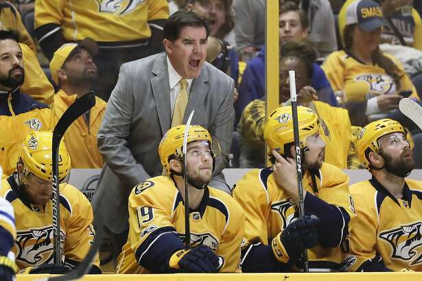 FILE - In this April 30, 2017 file photo, Nashville Predators head coach Peter Laviolette argues a call during the first period in Game 3 of a second-round NHL hockey playoff series against the St. Louis Blues in Nashville, Tenn.  The Stanley Cup has been handed out 89 times to the champion of the NHL since 1927. For the first time, two American coaches will face off in the final as the Nashville Predators' Peter Laviolette goes up against the Pittsburgh Penguins' Mike Sullivan. It's just the seventh time the Cup will be won by a U.S.-born coach. (AP Photo/Mark Humphrey)