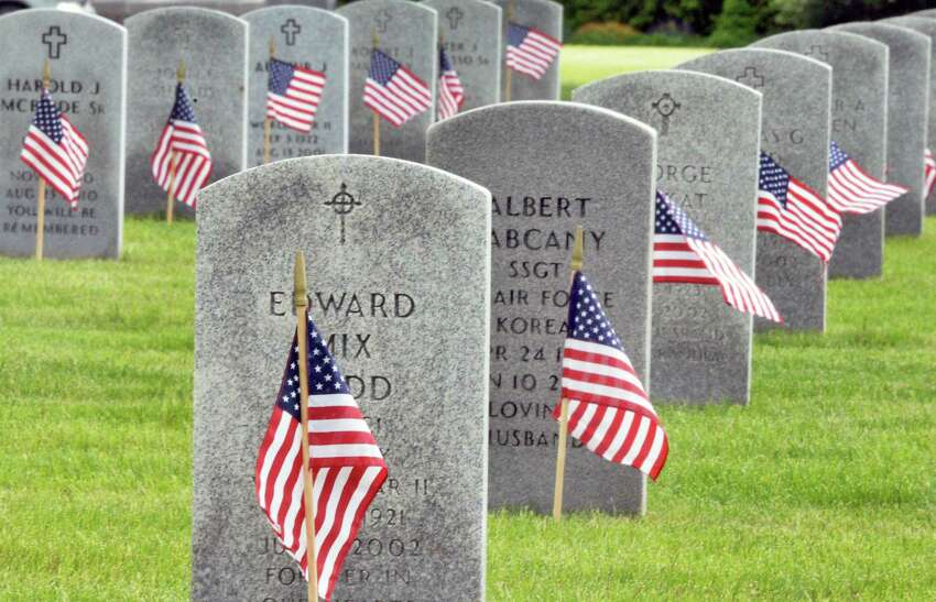 American flags are placed on over 15,000 graves for Memorial Day weekend at Saratoga National Cemetery Saturday May 27, 2017 in Schuylerville, NY. (John Carl D'Annibale / Times Union)
