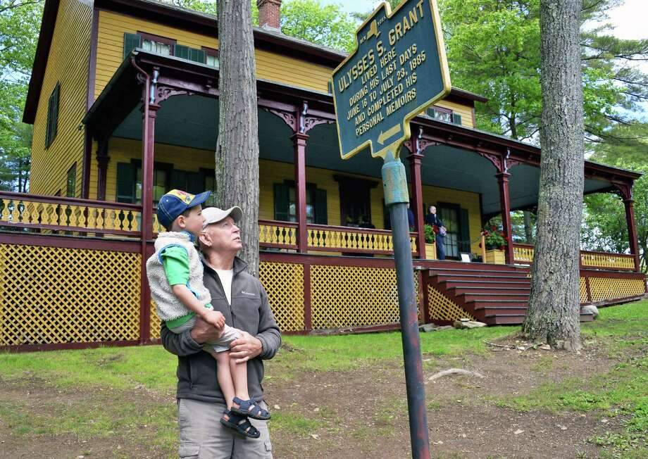 Four-year-old Hudson O'Brien of Sugarloaf, NY, and his grandfather Richard Bredenko of Lake Luzerne read an historic marker at Grant Cottage on May 27, 2017 in Wilton, N.Y. (John Carl D'Annibale / Times Union) Photo: John Carl D'Annibale / 20040566A