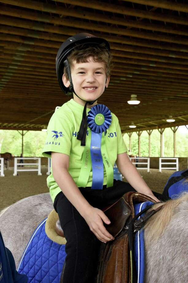 Kiernan Feltz of Wilton earned his therapeutic riding class's best transitions award at the 35th annual Pegasus Horse Show on May 20. Photo: Contributed Photo
