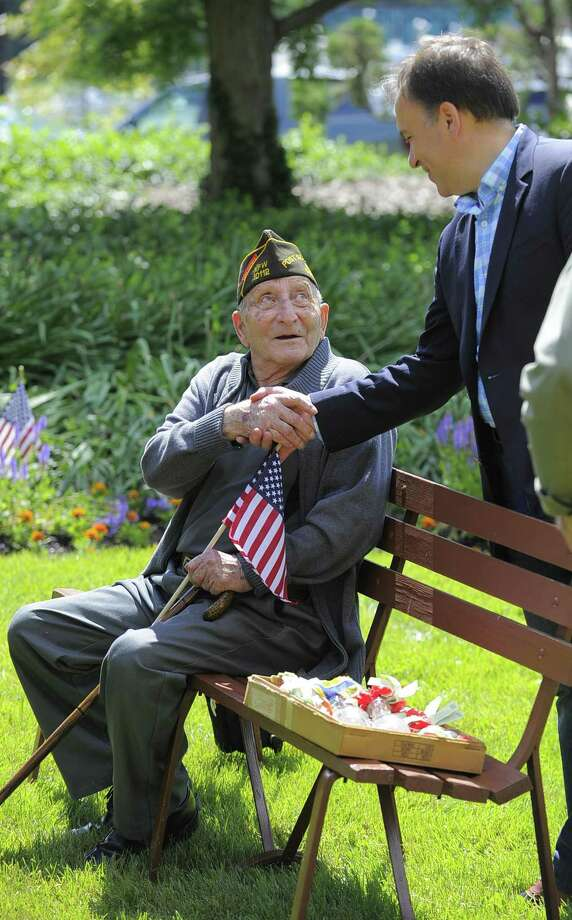 Fred Intrieri, 92, of Greenwich is greeted by Greenwich First Selectmen Peter Tesei prior to the Cos Cob VFW Post 10112 Memorial Day Ceremony to honor those who died for our country while serving in the United States Armed Services at the Cos Cob Dock VFW memorial in Greenwich, Conn. on Saturday, May 27, 2017. Intreri served in the Army during WWII. Photo: Matthew Brown / Hearst Connecticut Media / Stamford Advocate