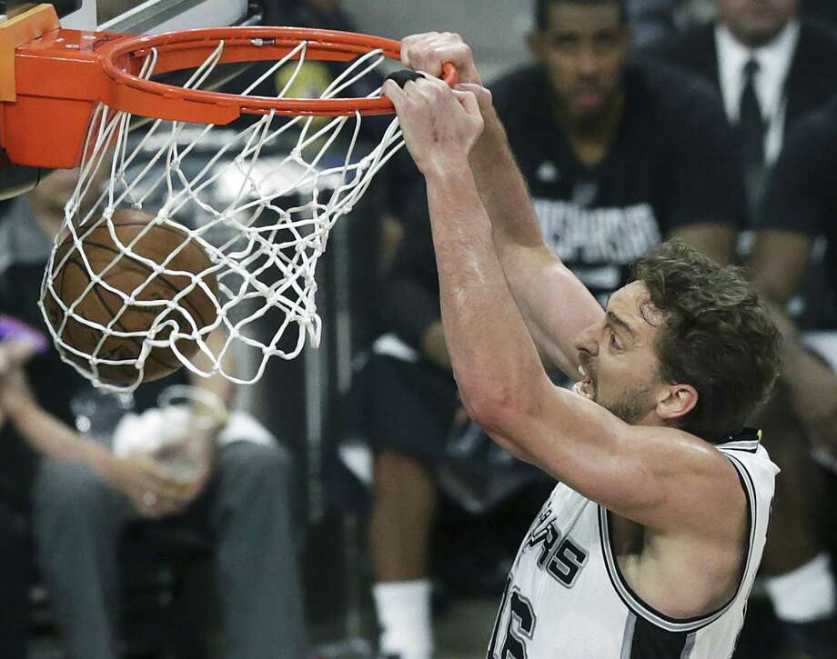 Pau Gasol slams one home a dunk in the first half as the Spurs host Golden State in Game 3 of the Western Conference finals at the AT&T Center on May 20, 2017. Photo: Tom Reel /San Antonio Express-News / 2017 SAN ANTONIO EXPRESS-NEWS