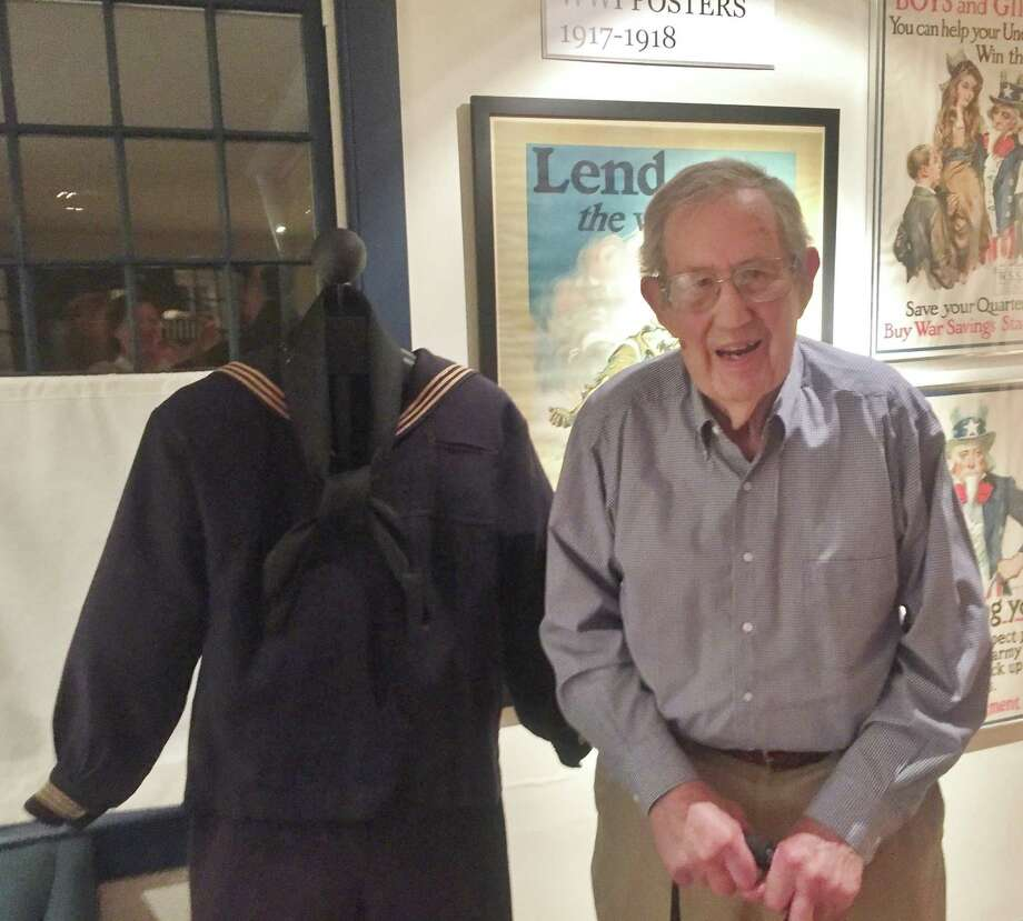 Carl Yoder with his father Leonard Yoder's 1918 dress Navy jumper, black neckerchief and bell-bottom pants, on display through Oct. 14, 2017 at the Wilton Historical Society. Photo: Contributed Photo / Wilton Historical Society