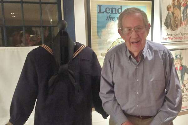 Carl Yoder with his father Leonard Yoder's 1918 dress Navy jumper, black neckerchief and bell-bottom pants, on display through Oct. 14, 2017 at the Wilton Historical Society.