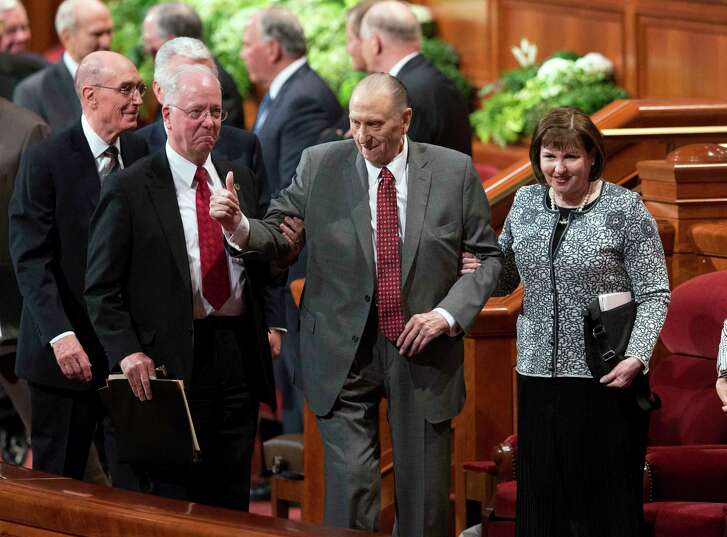 Thomas S. Monson, president of the Church of Jesus Christ of Latter-day Saints, is accompanied by his daughter, Ann Dibb, during a two-day Mormon church conference in Salt Lake City in April.