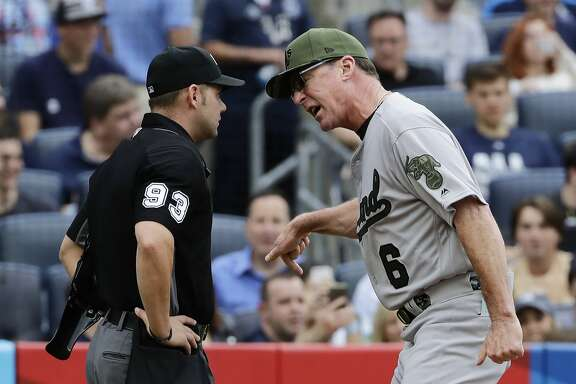 Oakland Athletics manager Bob Melvin (6) argues with umpire Will Little after being ejected from the game during the eighth inning of a baseball game against the New York Yankees Saturday, May 27, 2017, in New York. (AP Photo/Frank Franklin II)