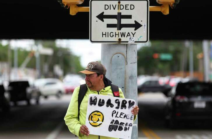 Andrew Quintanilla panhandles at the intersection of U.S. 59 South and Weslayan. Mayor Sylvester Turner has launched a campaign to discourage Houstonians from giving change to panhandlers.