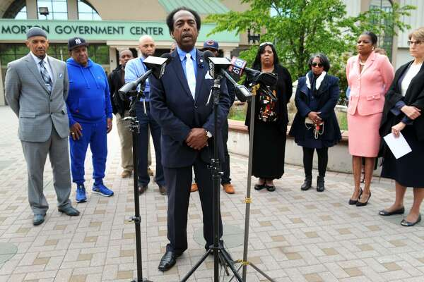 George Mintz, President of the Greater Bridgeport NAACP, is joined by other community representatives as he speaks at a press conference in front of the Morton Government Center in Bridgeport, Conn. May 11, 2017.